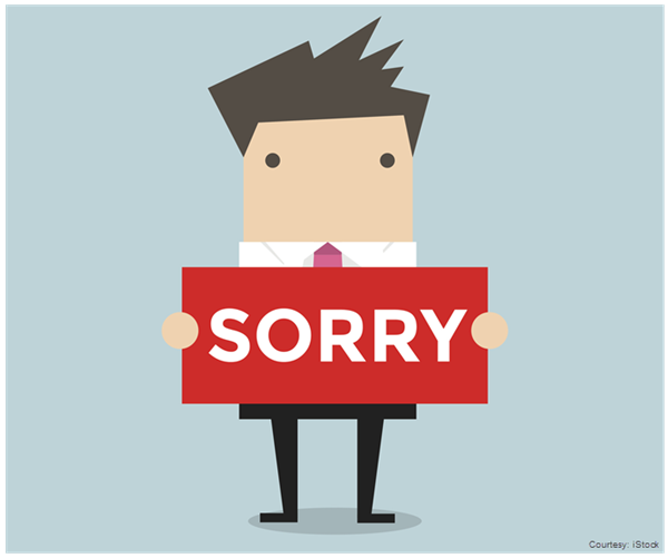 "Illustration of a man holding a ""Sorry"" card"