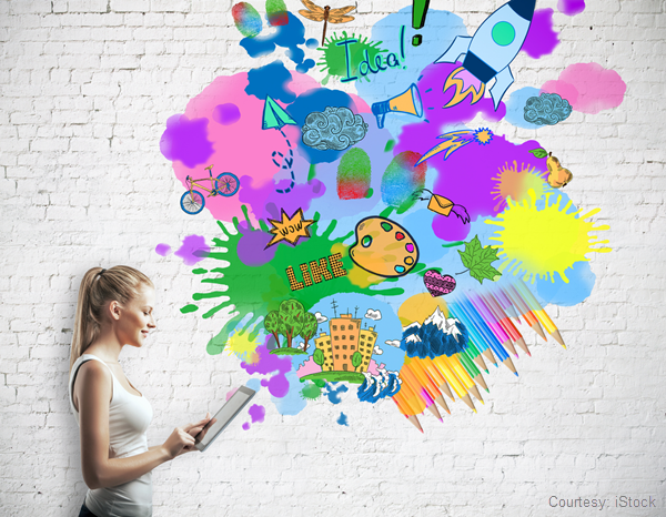 Stock photo of a woman with colorful innovative ideas coming from her tablet