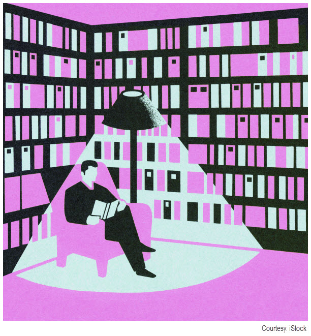 Purple graphic of a man reading a book in a library