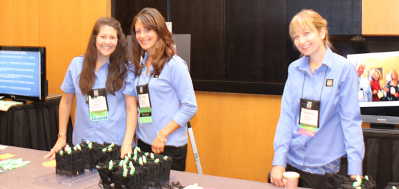 Kym, Crystal, and Jess handing out Forum badges