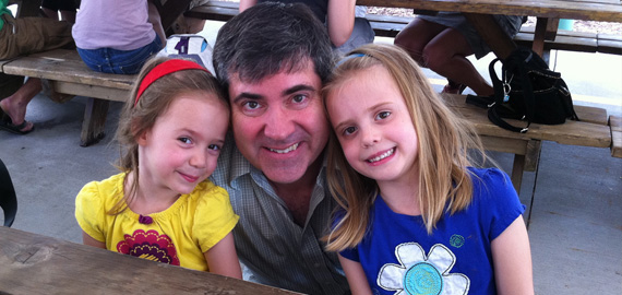 Steve and his daughters enjoying the summer picnic