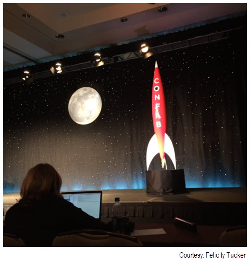 Photo of a large model rocket in a celestial setting at the 2015 Confab conference