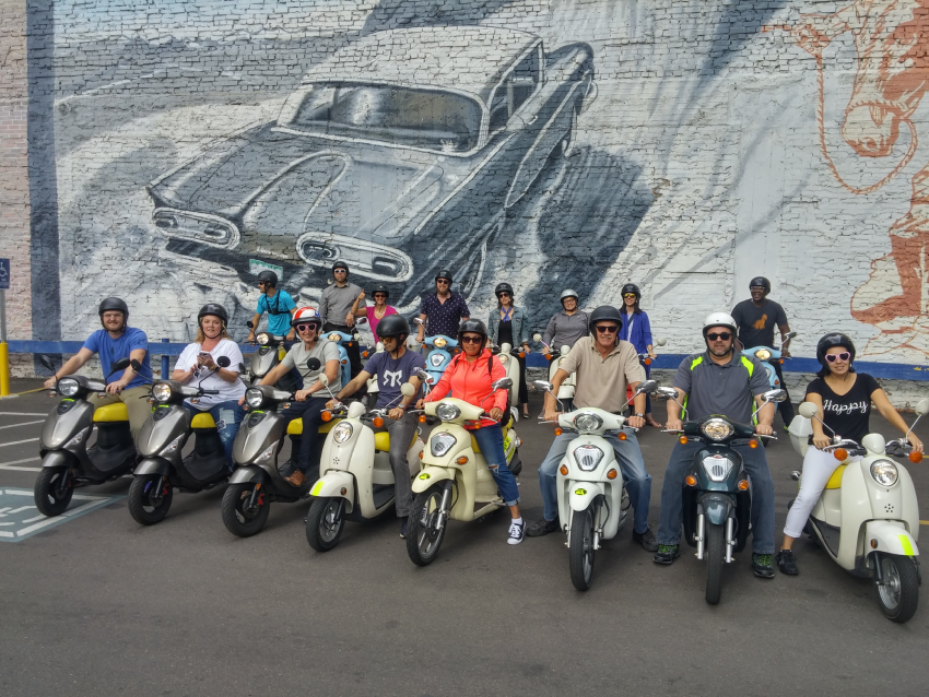 Image of Forum attendees enjoying a scooter tour